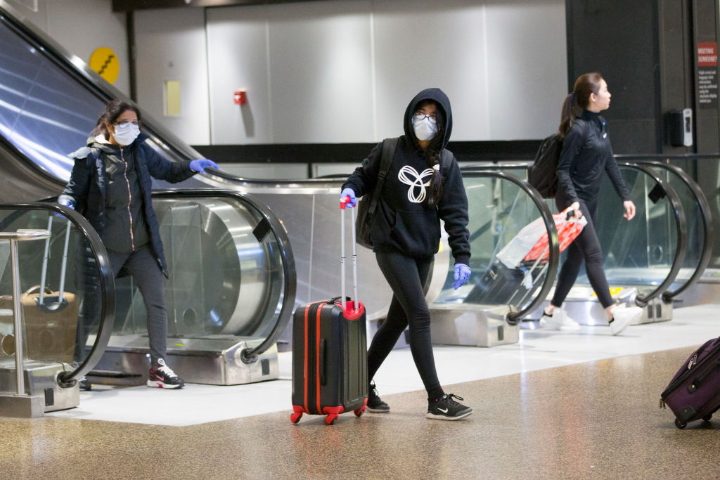 SEATTLE, WA - MARCH 08: Passengers arrive on an international flight at the SeattleTacoma International Airport (also known as Sea-Tac Airport) on March 8, 2020 in Seattle, Washington. The airline industry is seeing a global slowdown as a result of the novel coronavirus, COVID-19. (Photo by Karen Ducey/Getty Images)