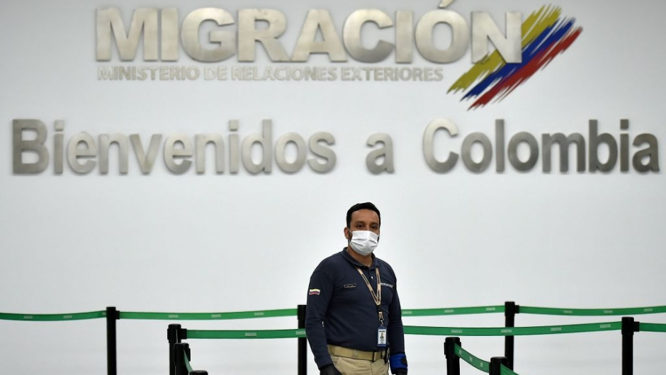 A Colombian Migration staffer waiting for passengers wears a protective face mask as a preventive measure against the spread of the new Coronavirus, COVID-19, at the Bonilla Aragon international airport in Palmira, Colombia, on March 10, 2020. (Photo by Luis ROBAYO / AFP) (Photo by LUIS ROBAYO/AFP via Getty Images)