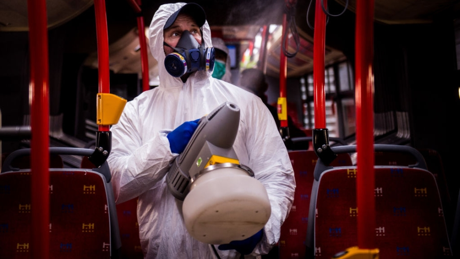 TOPSHOT - A worker wearing protective clothes disinfects an interior of a public bus in a bus-wash station at Transport Company of Bratislava city as part of precautionary measures against the spread of the new coronavirus COVID-19 in Bratislava, Slovakia on March 11, 2020. - Many schools were closed and public events were cancelled due to the coronavirus outbreak in Slovakia as first seven cases of infection were confirmed. (Photo by VLADIMIR SIMICEK / AFP) (Photo by VLADIMIR SIMICEK/AFP via Getty Images)