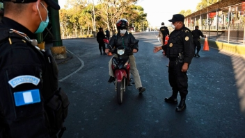 National Civil Police officers verify if people have authorization to circulate on the first day of a partial curfew announced by the government as a preventive measure against the spread of the new coronavirus COVID-19, on March 22, 2020. - Guatemalan authorities announced a mandatory isolation from 4 pm to 4 am as a preventive measure against the spread of COVID-19. (Photo by Johan ORDONEZ / AFP) (Photo by JOHAN ORDONEZ/AFP via Getty Images)