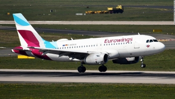 An aircraft of German Eurowings airline lands with seasonal workers from Romania at the airport in Duesseldorf, western Germany, on April 9, 2020 during the exit restrictions amid the new coronavirus / Covid-19 pandemic. - The federal government has agreed to fly in 80,000 foreign seasonal workers to Germany under strict conditions. The helpers are urgently needed for the asparagus harvest, among other things. Today, the first flights are scheduled to land at the airport in Duesseldorf as well as in Berlin-Schoenefeld. (Photo by INA FASSBENDER / AFP) (Photo by INA FASSBENDER/AFP via Getty Images)