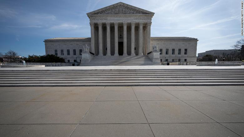 WASHINGTON, DC - MARCH 16: The U.S. Supreme Court stands on March 16, 2020 in Washington, DC. The Supreme Court announced on Monday that it would postpone oral arguments for its March session because of the coronavirus outbreak. (Photo by Drew Angerer/Getty Images)
