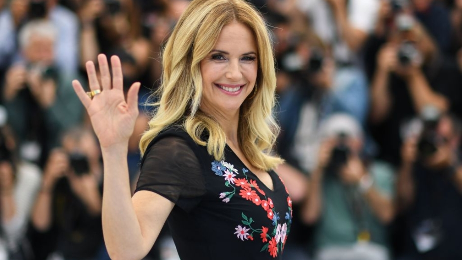 "TOPSHOT - US actress Kelly Preston poses on May 15, 2018 during a photocall for the film ""Gotti"" at the 71st edition of the Cannes Film Festival in Cannes, southern France. (Photo by Loic VENANCE / AFP) (Photo credit should read LOIC VENANCE/AFP via Getty Images)"