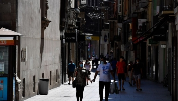 People walk down a shopping street in Lleida on July 4, 2020. - Spain's northeastern Catalonia region locked down an area with around 200,000 residents around the town of Lerida following a surge in cases of the new coronavirus. (Photo by Pau BARRENA / AFP) (Photo by PAU BARRENA/AFP via Getty Images)